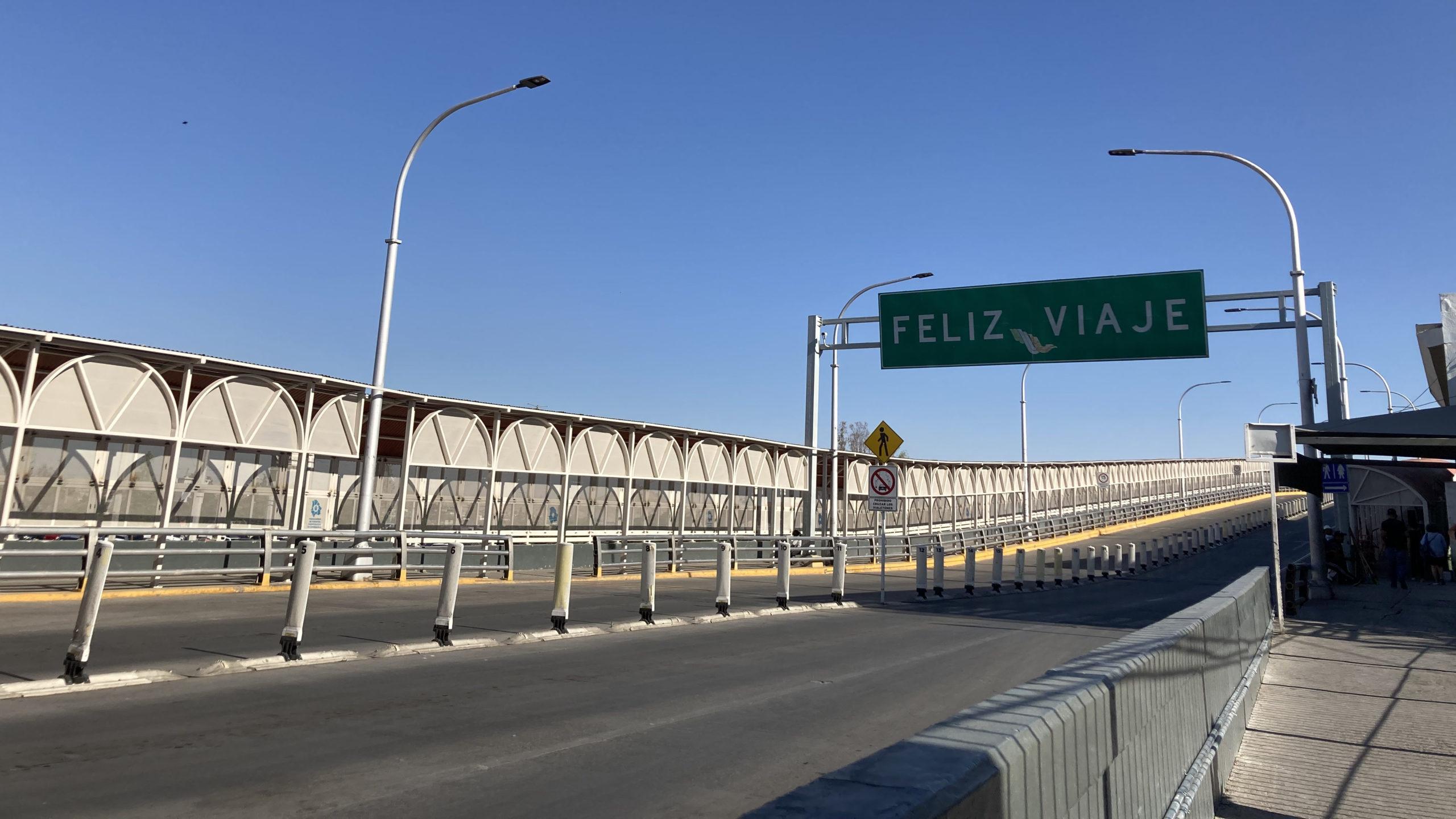 "An photo of a ""Feliz Viaje"" sign hanging over the Paso del Norte bridge, a U.S.-Mexico port of entry."